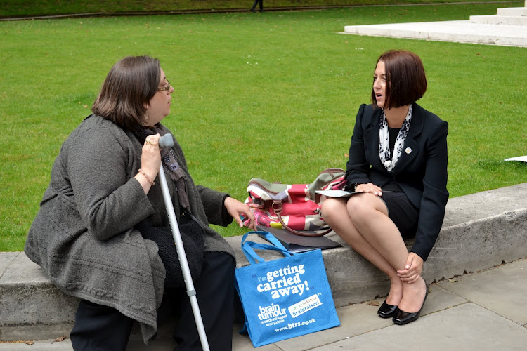 Nicole discusses the issues outside Parliament with other Mass Lobby attendees