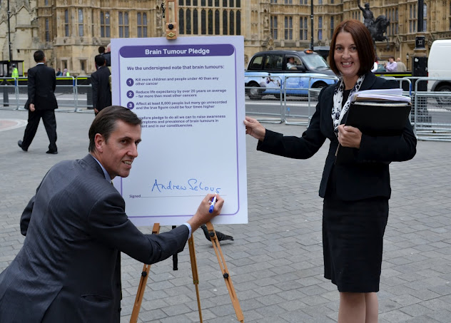 Nicole Witts with our Head First! patron MP Andrew Selous with the Pledge outside the Houses of Parliament