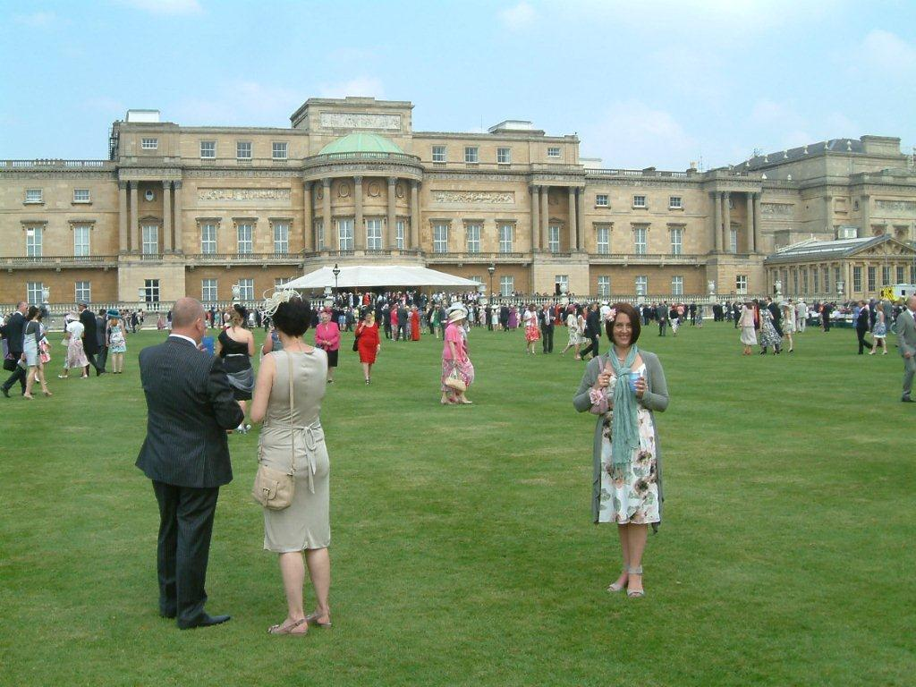 Nicole on the lawn behind Buckingham Palace